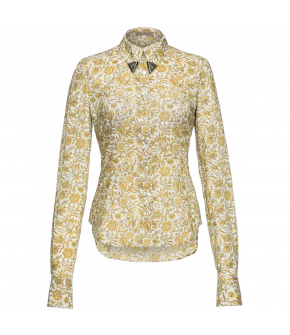 Classic slimfitting longsleeved blouse with detachable collar tips. This classic blouse is made from a light cotton featuring a beautiful floral Liberty print. Features a fully buttoned front and sleeve cuffs.