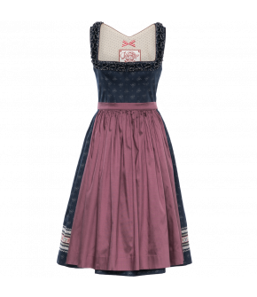 Printed blue Dirndl with handcrafted frogmouth frills around the neckline and contrasting piped silk details. The full skirt is trimmed with embroidered ribbons and has a hidden front pocket. The contrasting silk jacquard apron is gathered by hand. With H