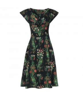 Waisted dress with overcut shoulders and decorative pleats across the bust. Made from beautiful botanical print fabric designed especially for the Wintergarden collection, this dress also features concealed side pockets. Falls just below the knee.