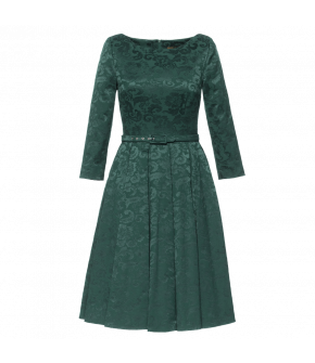 Classic knee length dress with a neat waist and wide flared skirt. Featuring a beautiful dark green Damask fabric, hidden side pockets, wide crew neckline. Fastens with a back zip. Lined.