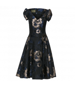 Fit-and-flare dress made of beautiful brocade with short tulip sleeves. Featuring a V-neckline and fitted top, the dress has a full skirt with gather details at the waist and concealed side pockets. Central back zip. Lined.