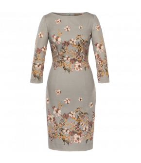 Tightfitting pencil dress with 3/4-length sleeves and pretty floral design. Featuring a high slashed neckline, a walking slit at the back and a matching fabriccovered belt. Back zip fastening. Fully lined.
