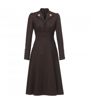 Flowing midi-dress with long sleeves. With a fitted top and waist, the dress features a button placket with fabric-covered buttons below the collar and has slight gathers under the bust. The collar is hand embroidered with flowers while the rounded sleeve