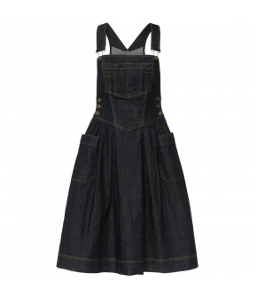 Denim dungaree dress with adjustable straps, fitted waistband and a wide skirt with large patch pockets. Featuring a bib pocket and decorative topstitching. Fastens with buttons at both sides.