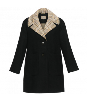 Oversized black woolen coat with a large collar. Featuring deep patch pockets and a detachable contrasting collar in a light tweed fabric. Fastens at the front with two horn buttons.