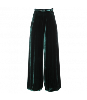 Sumptuous emerald green velvet pants with matching belt. This wide-legged style features a high-cut waistband with a narrow belt and side slash pockets. Fastens with a zip at the side.