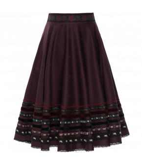 Full skirt in a deep wine shade embellished with embroidered ribbons at the waistband and hem. Featuring a lace trim hem, side zip fastening and concealed side-seam pockets.
