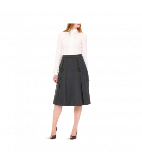 Elegant A-line skirt made from pure new wool with contrasting felted appliqué details at the front. This dark-grey skirt fastens at the side with a concealed zip and a button at the waist. Fully lined.
